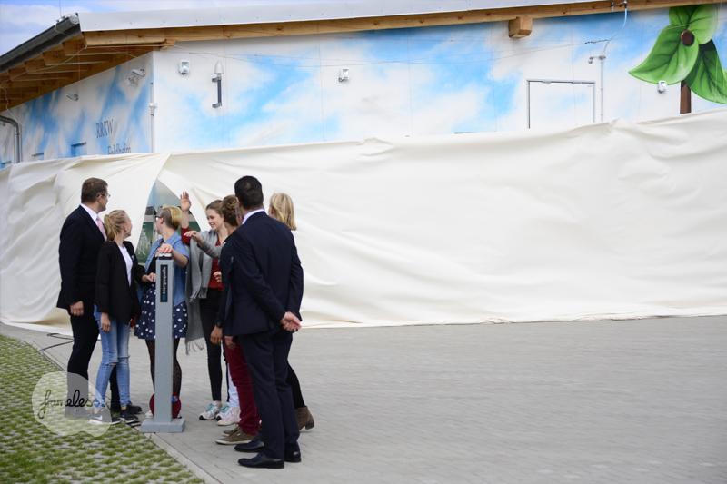 Feldheim, Energiequelle GmbH, Energiequelle, Frameless, Frameless-studio, Fassadengestaltung, Graffiti, Graffitiauftrag, Wandgestaltung, Enercon, Energiespeicher, Fassadenmalerei, Wandmalerei, Graffitikünstler